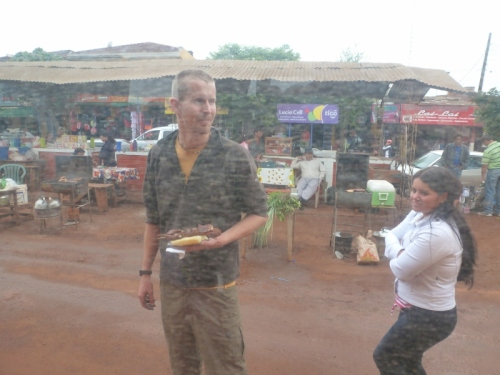 Hopping off the bus for some street food in Paraguay. Note the region's (Misiones) notorious red soil.