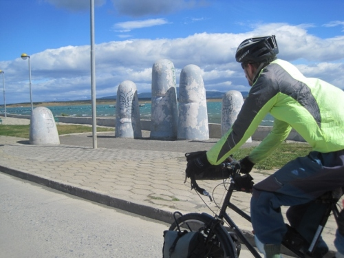Cycling past the sculptured sea-front of Puerto Natales