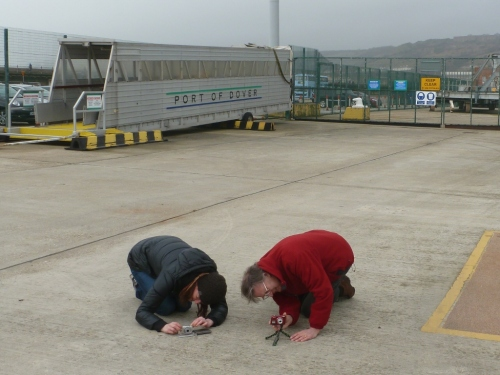 Two members of the Hannis family bow down in reverence to the returning cyclists...